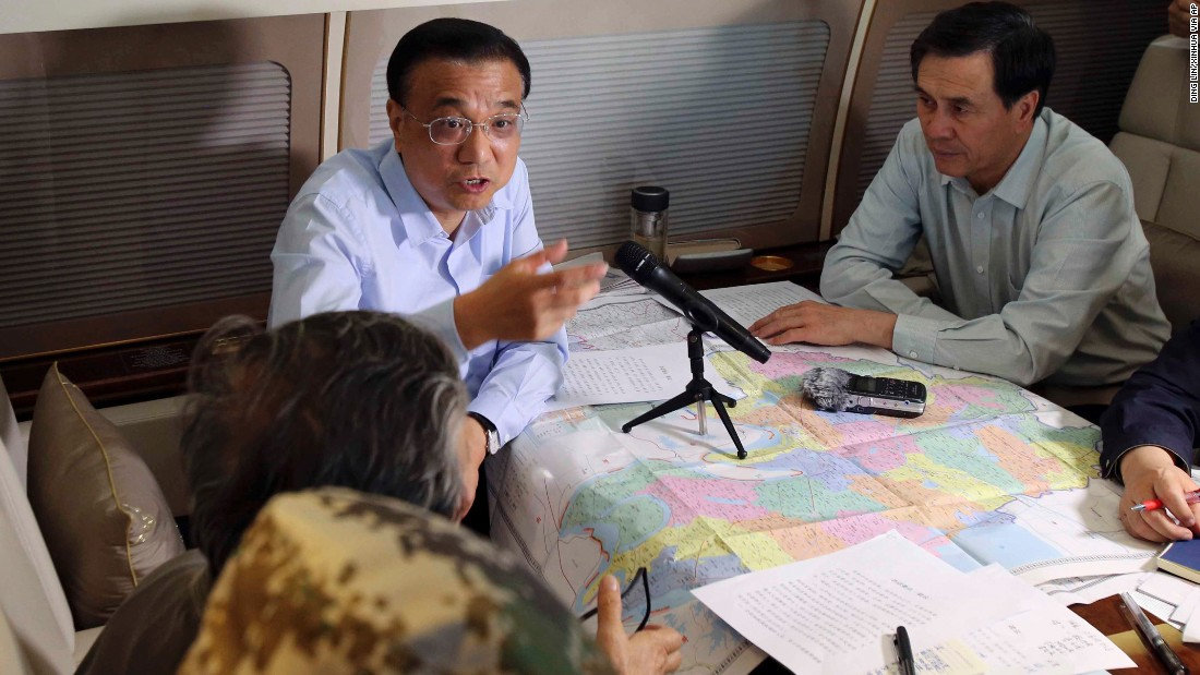 Chinese Premier Li Keqiang speaks aboard a plane en route to the ship on June 2.