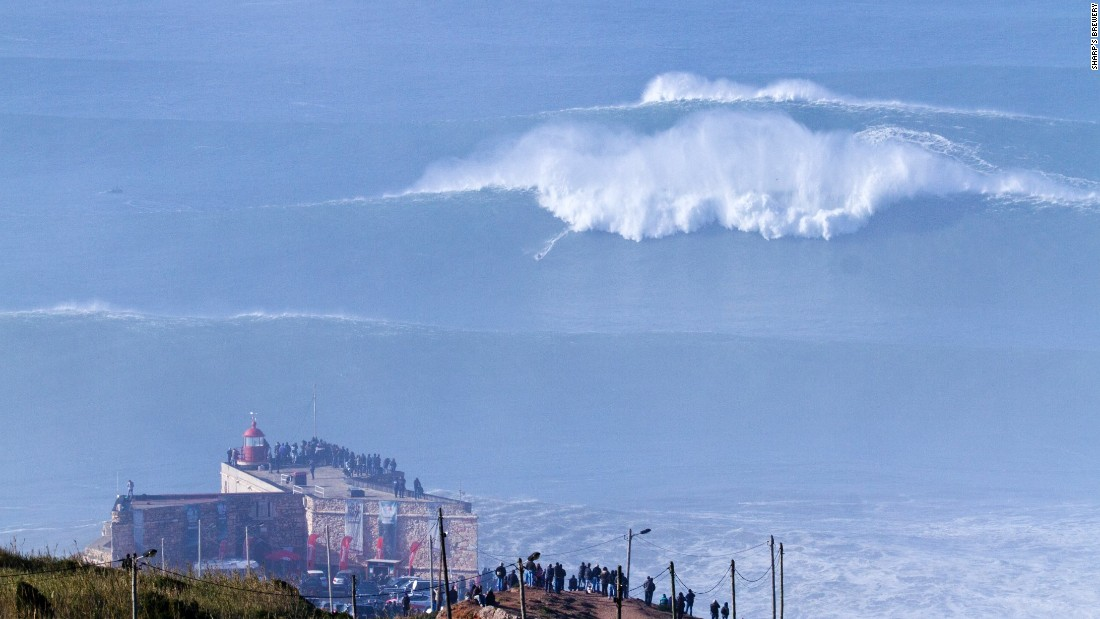 Cotton, a mere speck in the distance, gained global notoriety in late 2013 when he tackled a wave in Portugal estimated to be between 60-80 feet.