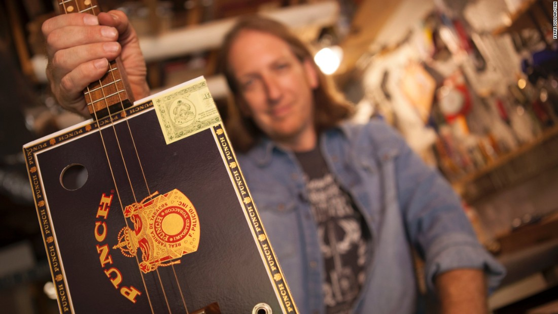 "Each guitar is handcrafted and no two are alike. Snowden holds up a three-string electric guitar made with a Punch cigar box, maple inlay and walnut fretboard. ""There's some kind of magic going on in the box. I don't know what it is. It doesn't sound like a banjo. It doesn't sound like a guitar. It's hard to describe,"" Snowden said. ""A bigger box has more of a deep tone. A smaller box has a tighter tone."""