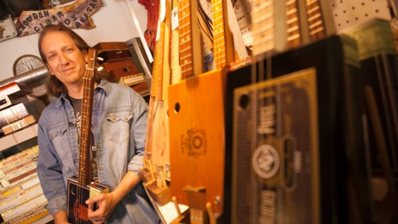 Snowden is a musician and a craftsman. He plays cigar box guitars as a one-man band and builds them from his garage.