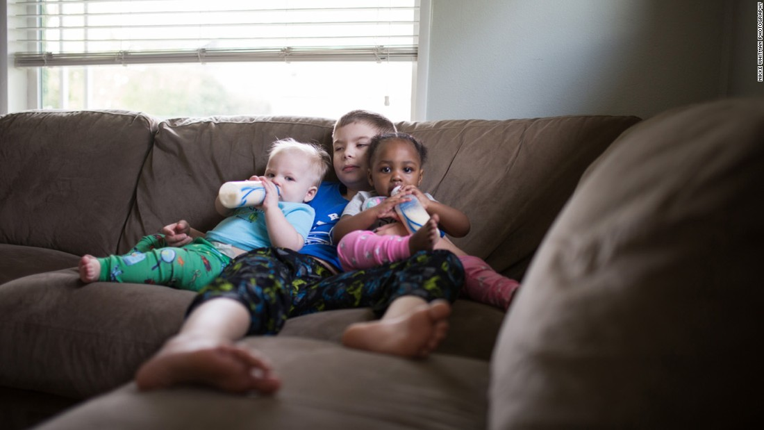 "Older brother Ethan was able to spend time with his siblings, Isaac and Ellie, during feedings. ""It was a team effort,"" Whitman said of bottle feeding."