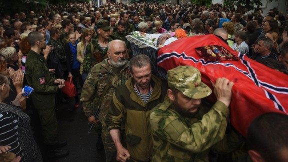 Pro-Russian rebels carry the coffin of prominent separatist commander Alexei Mozgovoi during his funeral in Alchevsk, Ukraine, on Wednesday, May 27.