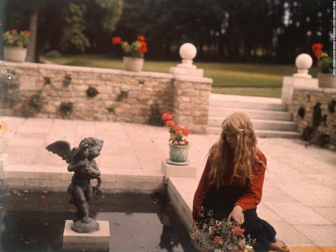 Seemingly unaware of the camera in almost every shot, the young girl is captured here while gazing into an ornamental pond.<br />The location for this photograph is not known, but it may possibly have been taken at the gardens of Rempstone Hall, near Corfe Castle, in Dorset.
