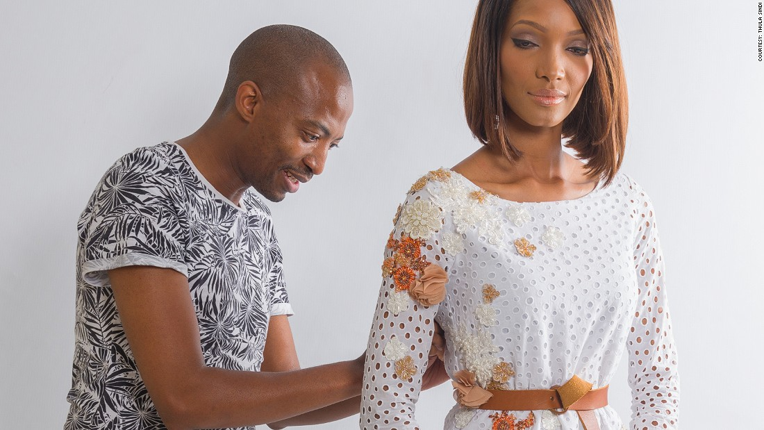 "Crowned South African Designer of the Year 2012 by SA Tourism, Sindi has developed a brand that exists ""between unrealistic high-end designer haute couture, and everyday retail chain/bargain bin clothing."""