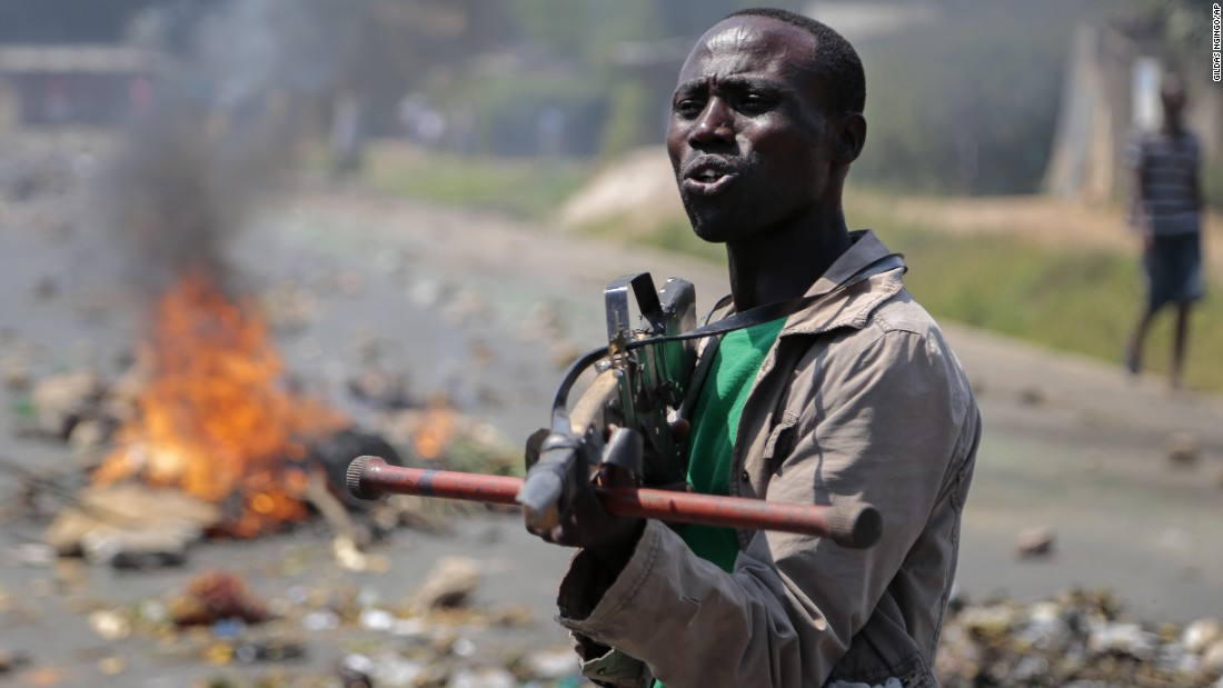 An opposition demonstrator points a mock gun at soldiers in Bujumbura, Burundi, on Wednesday, June 3. Animosity against Burundian President Pierre Nkurunziza boiled over in April when he expressed his intention to run for a third term. There have been demonstrations and a failed coup attempt.