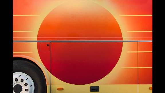 Though Holland has attempted to find the artists who use tour buses as a canvas, he's been unsuccessful.