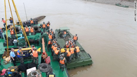 "Rescue personnel prepare to remove the remains of victims who were travelling on the capsized passenger ship Dongfangzhixing or ""Eastern Star"" in the Yangtze river at Jianli in China's Hubei province on June 3, 2015. Relatives of more than 400 people missing after a cruise ship capsized on China's Yangtze river were hoping for a ""miracle"" on June 3, as authorities said they were racing against time to find any survivors. CHINA OUT AFP PHOTOSTR/AFP/Getty Images"