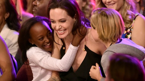 "Jolie hugs her children Zahara, left, and Shiloh after winning an award during Nickelodeon's Kids' Choice Awards in March 2015. Jolie won Favorite Villain for her role in ""Maleficent."""