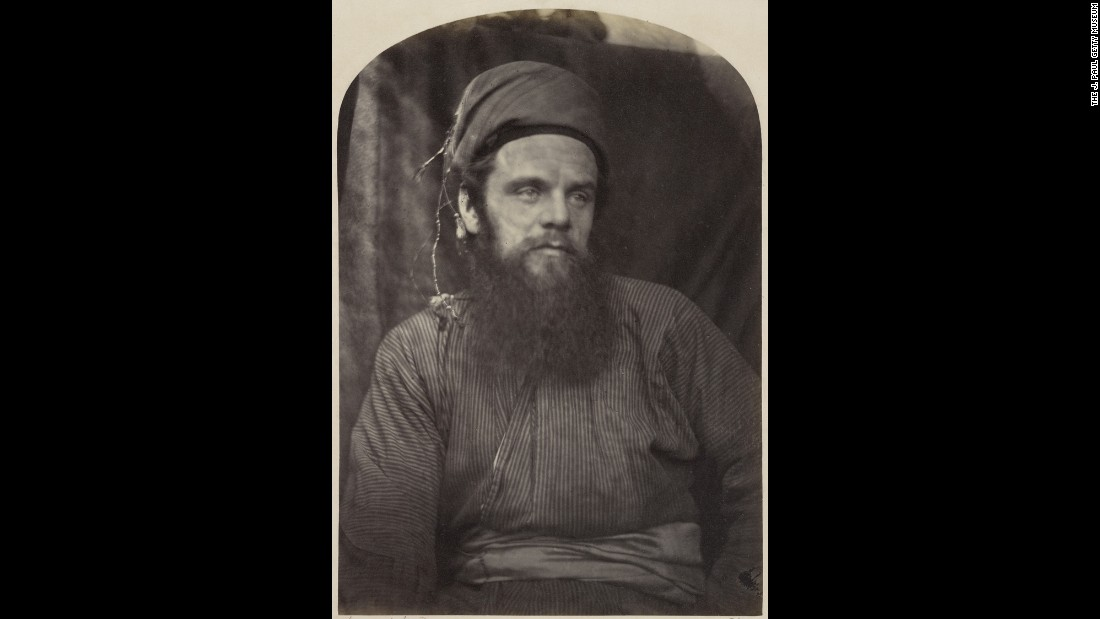 "Another Pre-Raphaelite, William Holman Hunt, painted such colorful and exacting works as ""The Hireling Shepherd"" and ""The Awakening Conscience."" He was fond of wearing Eastern dress, which is how Cameron caught him in 1864."