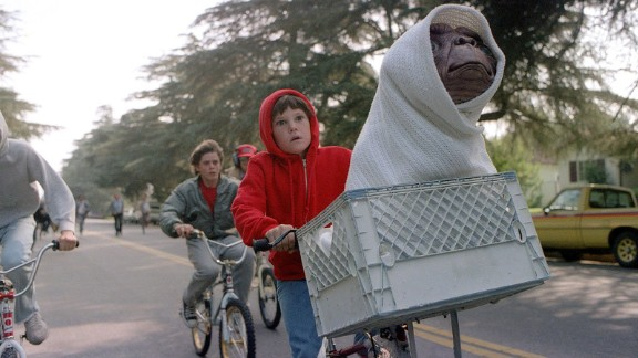 "Steven Spielberg's ""E.T.: The Extra-Terrestrial"" was released in 1982 and is the top-grossing movie of the 1980s. Keep clicking for the other top moneymaking movies of the decade."