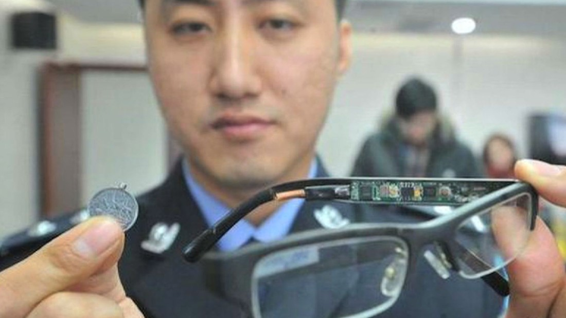 The stakes are so high some students have stooped to ingenious methods of cheating.  A police officer displays a device used by students to cheat in previous years.