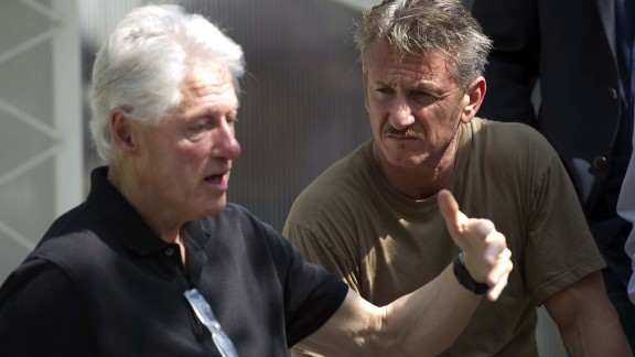 Clinton and actor Sean Penn visit a cholera treatment center in Port-au-Prince, Haiti, in February 2015.