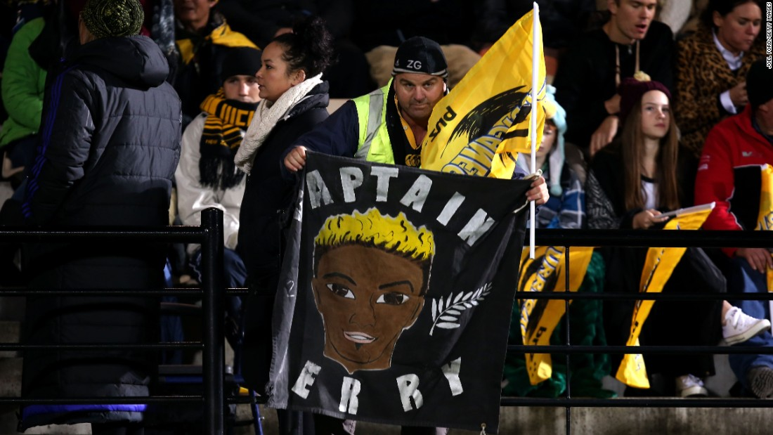 A Hurricanes fan holds a banner in memory of Collins during the Super Rugby match between the Hurricanes and the Highlanders. He played for the club between 2001 and 2008.