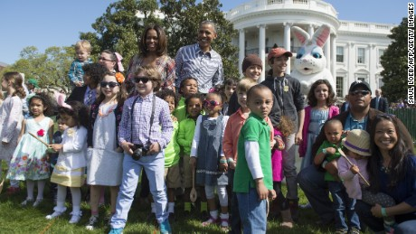 Obama and First Lady Michelle Obama greet children during the annual White House Easter Egg Roll on the South Lawn of the White House in Washington, DC, April 21, 2014.