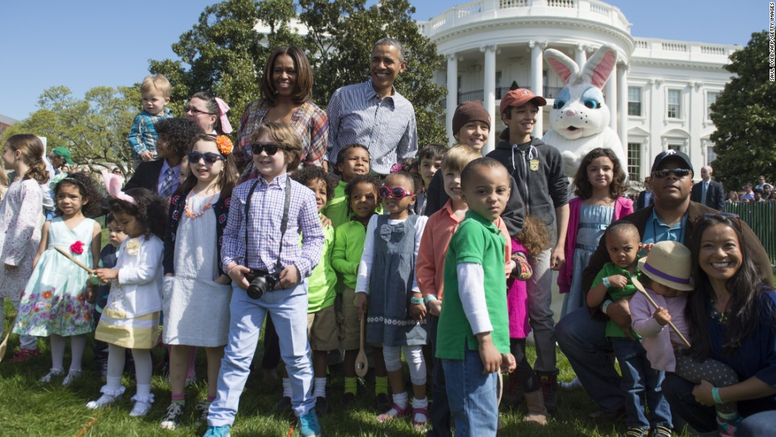 Obama and first lady Michelle Obama greet children during the White House Easter Egg Roll in April 2014.