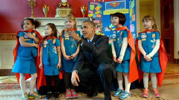 Obama poses with girl scouts from Tulsa, Oklahoma during the 2015 White House Science Fair March 23, 2015 in Washington, DC.