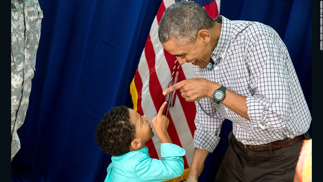Obama and a young boy point at each other at Marine Corps Base Hawaii on Christmas Day.