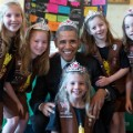 Obama with girls wearing crown