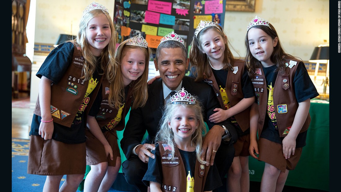 Obama poses with a Girl Scout Brownie from Tulsa, Oklahoma, after they showed off a science fair exhibit, a flood-proof bridge made of Legos.