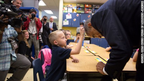 Obama allows first grader Edwin Caleb to touch his hair during a classroom visit at Clarence Tinker Elementary School at MacDill Air Force Base in Tampa, Florida on Sept. 17, 2014.
