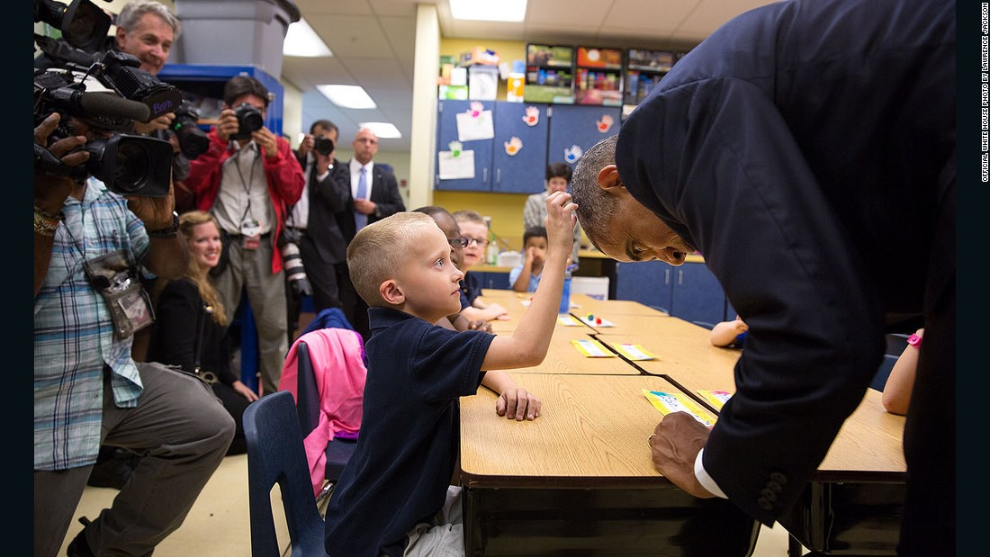 Obama allows first-grader Edwin Caleb to touch his hair during a classroom visit at Clarence Tinker Elementary School at MacDill Air Force Base in Tampa, Florida, in September.