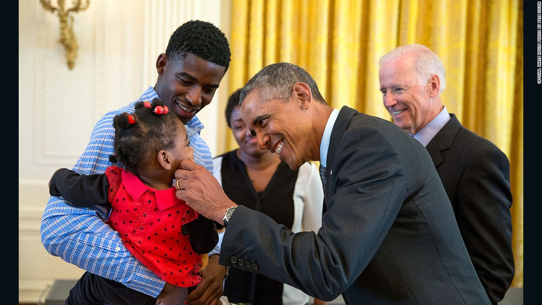 Obama greets a child during a tour of the White House in September.