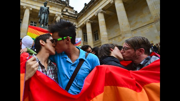 Same-sex couples kiss during a protest by the LGBT community at the Bolivar Square in Bogota,Colombia, in November 2012.