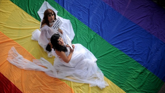 Supporters of LGBT at the University of the Philippines campus in Manila celebrate Pride Month on June 27, 2013.