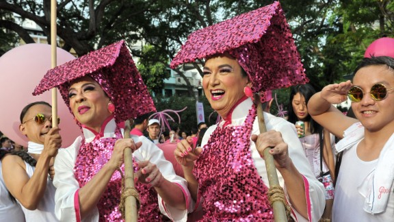 """Singaporeans dress in pink in support of gays and lesbians as they gather at """"Speakers' Corner"""" in Singapore in June, 2014."""