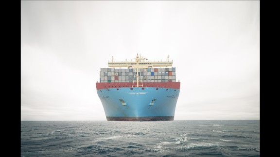 """The massive Maersk Majestic travels in the South China Sea in February 2014. The Majestic and its sister ships are taller than a 20-story building, and they are too wide to pass through the Panama Canal. """"When you really see it, it's just insane,"""" said photographer Gregers Heering, who spent 32 days aboard the Majestic last year."""