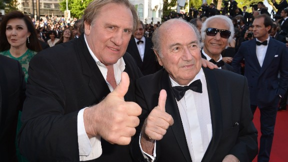 French actor Gerard Depardieu (L) and FIFA President Sepp Blatter give a thumbs-up as they arrive for the screening of the film