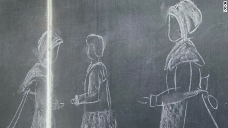 100 year old classroom chalkboard discovered_00004309