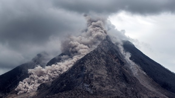 Thick ash, rock fragments and volcanic gases pour from Mount Sinabung in Indonesia. The government's natural disaster management agency raised the alert level on June 5, 2015.
