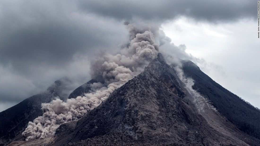 "Thick ash, rock fragments and volcanic gases pour from <a href=""http://ireport.cnn.com/docs/DOC-1246978"">Mount Sinabung</a> in Indonesia. The government's natural disaster management agency raised the alert level on June 5, 2015."