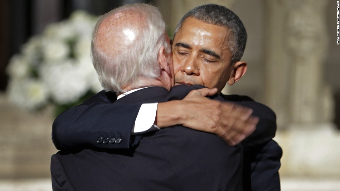 "President Barack Obama hugs Joe Biden after delivering the eulogy on June 6. In his eulogy, Obama credited the vice president with inspiring in his son a devotion to public service and to family, jokingly calling him ""Joe 2.0."""