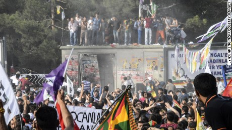 People gesture after an explosion during a rally by the Kurdish Peoples' Democratic Party in Diyarbakir.