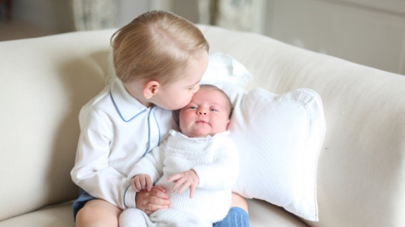 Princess Charlotte is seen with her big brother for the first time in a photo released by Kensington Palace in June 2015.