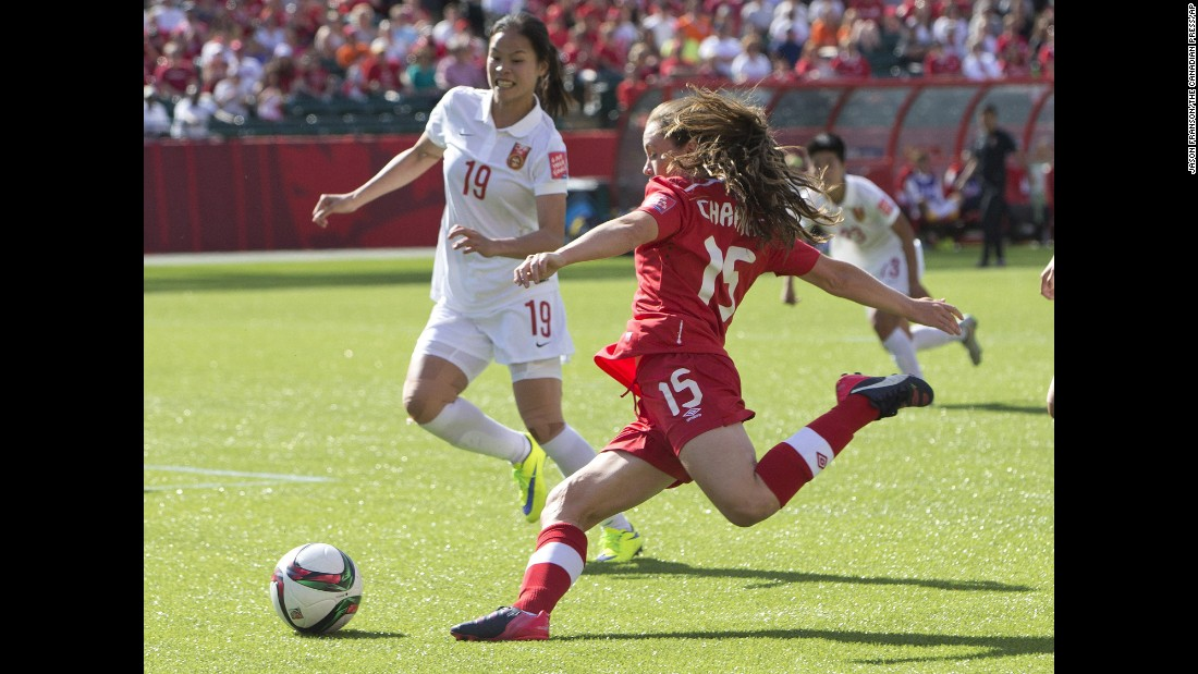 Canada's Allysha Chapman looks to cross the ball as China's Tan Ruyin defends.