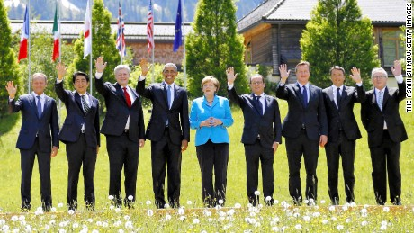 Members of the G7 pose for their group photo. From left to right: President of the European Council Donald Tusk, Japanese Prime Minister Shinzo Abe, Canada's Prime Minister Stephen Harper, U.S. President Barack Obama, German Chancellor Angela Merkel, French President Francois Hollande, British Prime Minister David Cameron, Italian Prime Minister Matteo Renzi and President of the European Commission Jean-Claude Juncker.