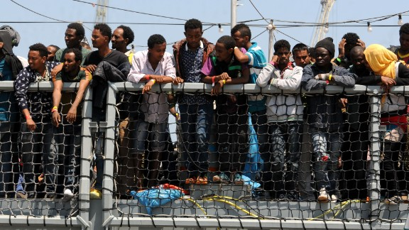 Migrants wait to disembark from the German navy ship Hessen in Palermo, Italy, on Sunday, June 7. European rescue boats are bringing thousands of migrants to safety as they try to cross the Mediterranean Sea. There has been a surge in the number of migrants making the dangerous journey toward Europe's shores.