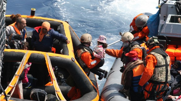 Soldiers from the German frigate Hessen help refugees in the Mediterranean on Saturday, June 6.