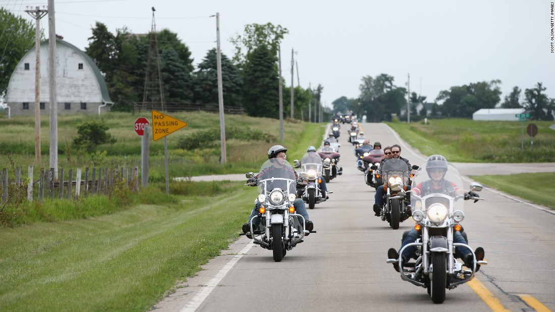 Wisconsin Gov. Scott Walker and freshman Sen. Joni Ernst, R-Iowa, lead a group of bikers during a Roast and Ride hosted by Ernst on Saturday, June 6, in Boone, Iowa. Ernst is hoping the event, which featured a motorcycle tour, a pig roast and speeches from several 2016 presidential hopefuls, becomes an Iowa Republican tradition.