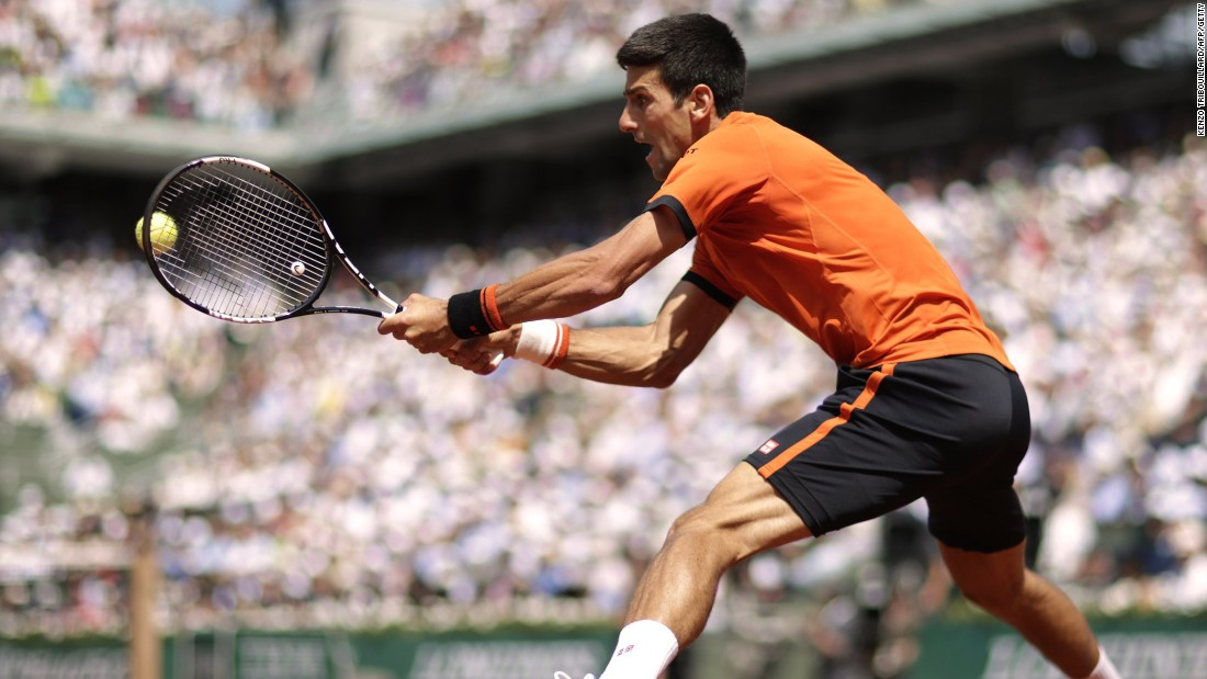 Djokovic powers a backhand as he took the opening set of his final against Wawrinka in Paris.