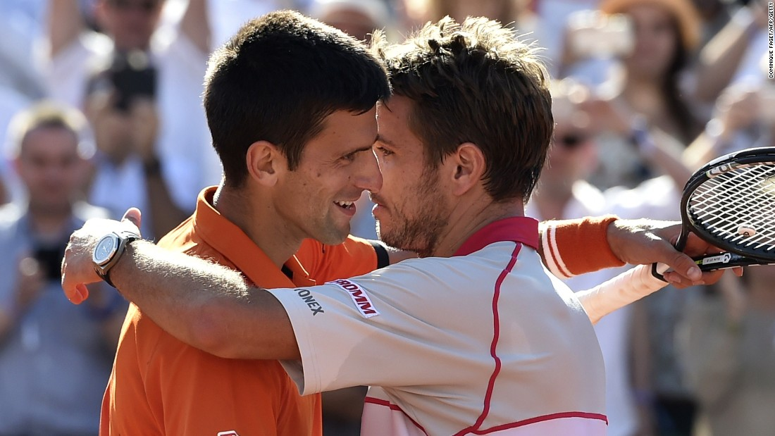 The two finalists sportingly embrace at the net after Wawrinka's upset victory over the world number one Djokovic.