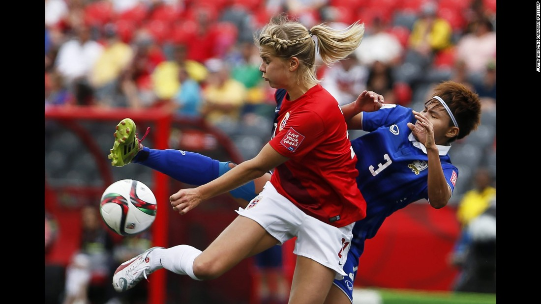 Norway's Ingrid Moe Wold tries to keep Chinwong away from the ball.