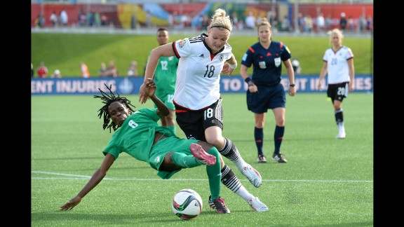 Ivory Coast midfielder Rita Akaffou, left, battles Germany forward Alexandra Popp in the second half of the match.