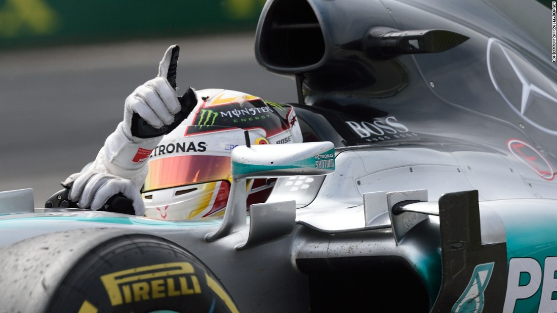 Hamilton makes it win number three in Montreal -- one of his favorite GP venues. Here, he signals victory at the Canadian GP where he beat Mercedes teammate Nico Rosberg.