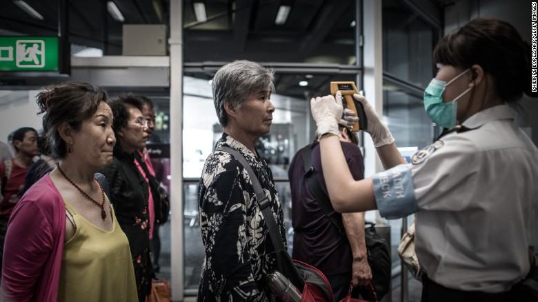 Passengers get their temperature checked in 2015 as part of preventive measures against the spread of MERS at Hong Kong airport.