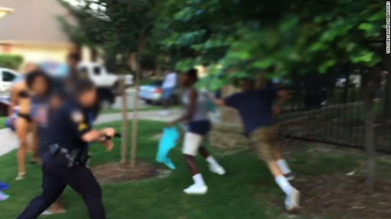 Video shows officer pull out gun to break up pool party
