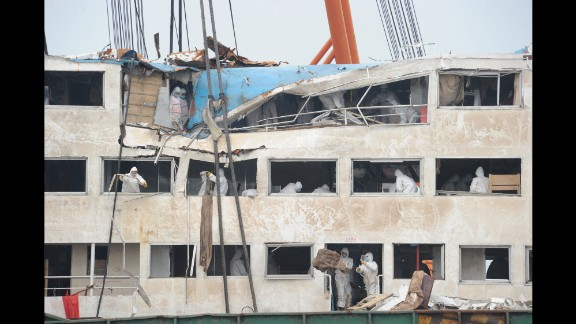 Workers remove debris from the Eastern Star ship on the Yangtze River in China